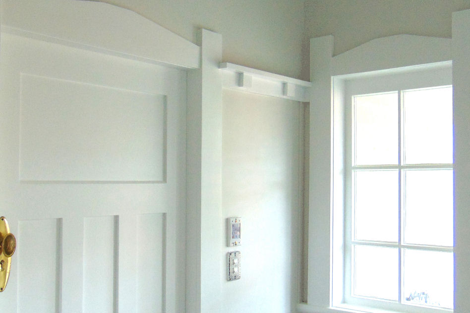 A beautiful window and villa door painted white.